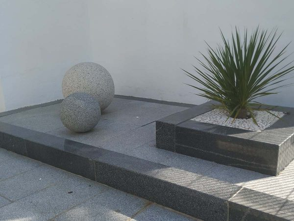 Garden with decorative granite bollards